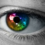 Image of man's rainbow eye close up