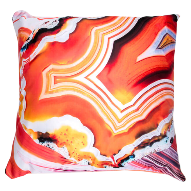 Throw pillow with abstract design colored red and orange